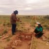 Two Native American archaeology students conduct research in Petrified Forest National Park in June 2015 as part of a field school project.