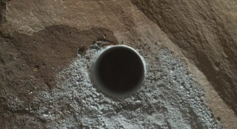 On April 24, 2016, NASA's rover Curiosity photographed a hole drilled into the surface of Mars to test the composition of Martian rocks.