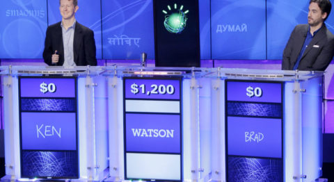 game theory anthropology - Jeopardy! champions Ken Jennings, left, and Brad Rutter, right, look on as the IBM computer Watson beats them to the buzzer to answer a question during a practice round of the quiz show in Yorktown Heights, New York.
