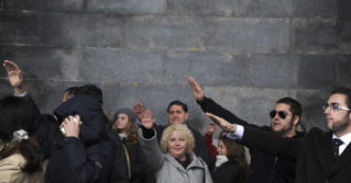 People make the fascist salute on November 20, 2011, at the Valley of the Fallen—the basilica near Madrid, Spain, where the country's former dictator Gen. Francisco Franco is entombed—after a mass commemorating the 36th anniversary of Franco's death.
