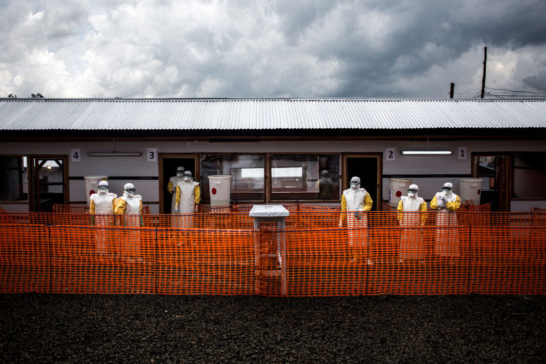In November, health workers gather inside an Ebola treatment center in Bunia, Democratic Republic of the Congo.
