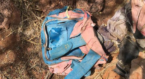 mexico border - A child's backpack abandoned on a migrant trail in the Tumacácori Mountains suffers the decay of time.