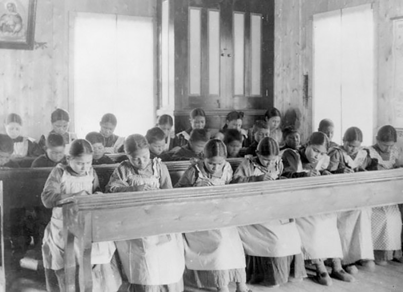 language preservation - In Canada during the 19th and 20th centuries, many Indigenous children were forced to attend residential schools like this one in Fort Resolution, Northwest Territories, where they were punished for speaking their native languages.
