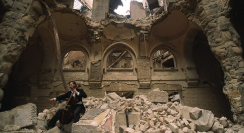 Bosnian cellist Vedran Smailovic plays an elegy in Sarajevo's blasted and burned library.