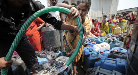 Water scarcity - Residents in Mumbai collect water at a community tank.