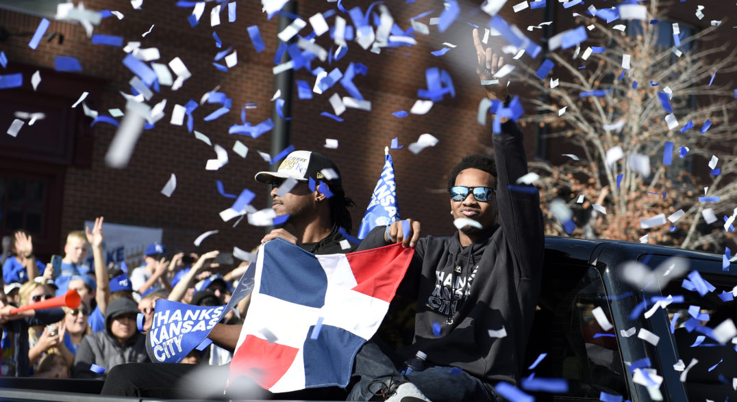baseball bilingualism - Dominican-born Yordano Ventura, Kansas City Royals' starting pitcher, holds up a Dominican flag following the team's World Series victory in 2015. (Ventura died tragically in 2017.)