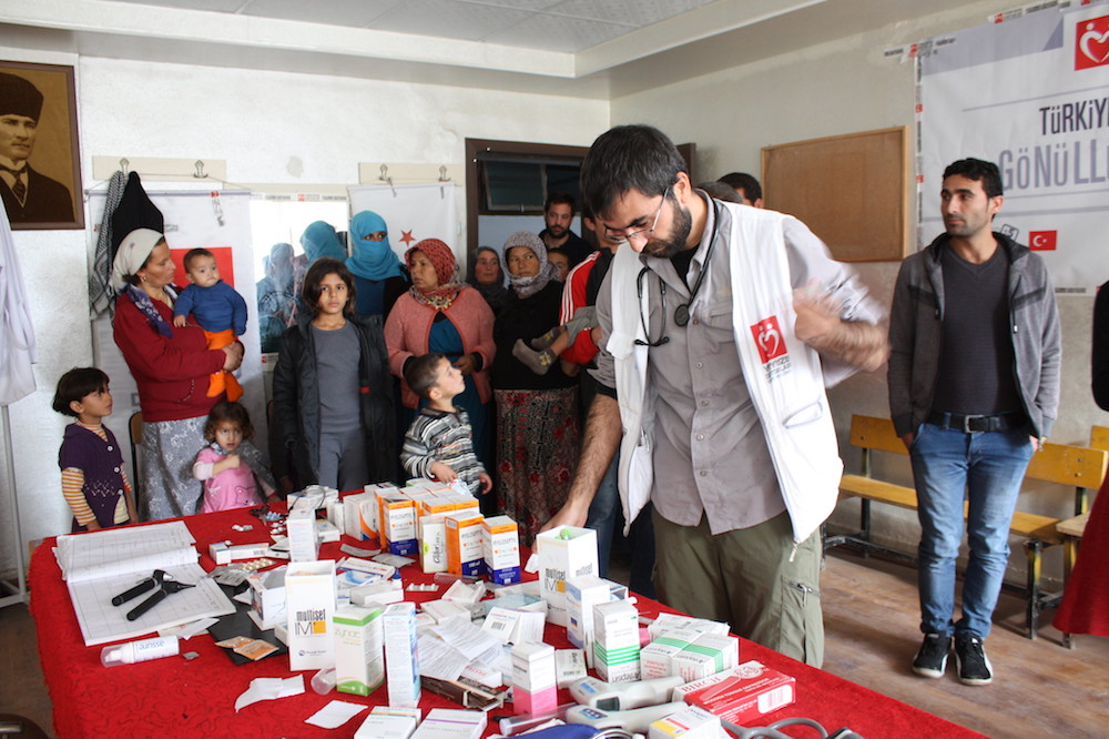 hospitality in turkey - A doctor treats patients at a government-run camp for Syrian refugees in Turkey.